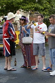 Queen Elizabeth II 90th birthday celebration weekend, drinkers at a street party Alcester Warwickshire - John Harris - 2010s,2016,2nd,90th,alcohol,birthday,BIRTHDAYS,campfire,CELEBRATE,CELEBRATING,celebration,CELEBRATIONS,communities,community,costume,costumes,dressed up,dressing up,drink,drinker,drinkers,drinking,dri