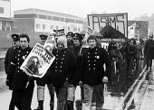 Firefighters National Strike, 1977. Firemen on strike for more pay march from Old Street Fire Station to Bethnal Green, east London, in support of their ten percent pay claim - John Sturrock - 1970s,1977,activist,activists,adult,adults,ASTMS,banner,banners,CAMPAIGN,campaigner,campaigners,CAMPAIGNING,CAMPAIGNS,claim,DEMONSTRATING,demonstration,DEMONSTRATIONS,disputes,EARNINGS,FBU,fire,fire b