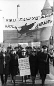 FBU National Strike, 1977. Firefighters on strike for more pay protest in support of their pay claim, Liverpool - John Sturrock - 1970s,1977,activist,activists,adult,adults,banner,banners,CAMPAIGN,campaigner,campaigners,CAMPAIGNING,CAMPAIGNS,claim,Clwyd,DEMONSTRATING,demonstration,DEMONSTRATIONS,disputes,dragon,EARNINGS,FBU,FEMA