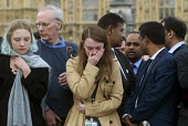 Vigil in Parliament Square for Jo Cox MP. Ruth Price Parliamentary Assistant for Jo Cox MP at the House of Commons is distraught as she looks at the floral tributes. Vigil in Westminster for murdered... - Stefano Cagnoni - 2010s,2016,Assistant,ASSISTANTS,bouquet,bouquets,COMMEMORATE,COMMEMORATING,commemoration,COMMEMORATIONS,cry,crying,death,deaths,died,distress,emotion,emotional,emotions,FEMALE,FLOWER,flowering,flowers