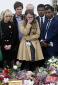 Vigil in Parliament Square for Jo Cox MP. Ruth Price Parliamentary Assistant for Jo Cox MP at the House of Commons is distraught as she looks at the floral tributes. Vigil in Westminster for murdered... - Stefano Cagnoni - 2010s,2016,Asian,Asians,Assistant,ASSISTANTS,BAME,BAMEs,black,BME,bmes,bouquet,bouquets,COMMEMORATE,COMMEMORATING,commemoration,COMMEMORATIONS,cry,crying,death,deaths,died,distress,diversity,emotion,e