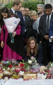 Vigil in Parliament Square for Jo Cox MP. Woman in visible distress as she looks at the floral tributes. Vigil in Westminster for murdered Labour MP, Jo Cox, London - Stefano Cagnoni - 17-06-2016