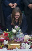 Vigil in Parliament Square for Jo Cox MP. Woman in visible distress as she looks at the floral tributes. Vigil in Westminster for murdered Labour MP, Jo Cox, London - Stefano Cagnoni - 2010s,2016,bouquet,bouquets,candle,candles,COMMEMORATE,COMMEMORATING,commemoration,COMMEMORATIONS,cry,crying,death,deaths,died,emotion,emotional,emotions,FEMALE,floral,flower,flowering,flowers,grief,g