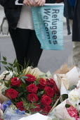 Jo Cox murder. Convoy to Calais supporters looking at flowers and messages left for murdered Labour MP Jo Cox, Parliament Square, London - Stefano Cagnoni - 18-06-2016