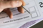 Filling in EU referendum postal vote - Paul Box - 2010s,2016,ballot,ballot papers,BALLOTING,ballots,choice,choosing,deciding,decisions,democracy,EU,Europe,European Union,fill,filling,fills,leave,paper,people,POL,political,POLITICIAN,POLITICIANS,Polit