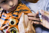 Meningitus vaccination paid for privately, Cardiff - Paul Box - 2010s,2016,boy,boys,care,child,CHILDHOOD,children,clinic,clinics,doctor,doctors,HEA,Health,Health Worker,health workers,healthcare,hypodermic,injecting,injection,inoculated,inoculation,inoculations,in