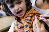 Meningitus vaccination paid for privately, Cardiff - Paul Box - 2010s,2016,boy,boys,care,child,CHILDHOOD,children,clinic,clinics,cry,crying,doctor,doctors,HEA,Health,Health Worker,health workers,healthcare,hypodermic,injecting,injection,inoculated,inoculation,inoc