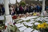 Jo Cox murder. Flowers and tributes left in Parliament Square for murdered Labour MP, Jo Cox, Westminster, London - Jess Hurd - 2010s,2016,bouquet of flowers,Bunch of Flowers,candle,candles,death,deaths,died,flower,flowering,flowers,grieving,Jo Cox,kill,killed,killing,Labour Party,London,memorial,message,messages,mortality,MOU