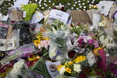 Jo Cox murder. Flowers and tributes left in Parliament Square for murdered Labour MP, Jo Cox, Westminster, London - Jess Hurd - 2010s,2016,bouquet of flowers,Bunch of Flowers,death,deaths,died,flower,flowering,flowers,grieving,Jo Cox,kill,killed,killing,Labour Party,London,memorial,mortality,MOURNER,MOURNERS,mourning,MP,murder