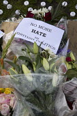 Jo Cox murder. Flowers and tributes left in Parliament Square for murdered Labour MP, Jo Cox, Westminster, London - Jess Hurd - 2010s,2016,bouquet of flowers,Bunch of Flowers,death,deaths,died,flower,flowering,flowers,grieving,hate,hatred,Jo Cox,kill,killed,killing,Labour Party,London,memorial,message,messages,mortality,MOURNE