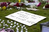 Jo Cox murder. Flowers and tributes left in Parliament Square for murdered Labour MP, Jo Cox, Westminster, London - Jess Hurd - 2010s,2016,candle,candles,death,deaths,died,FLOWER,flowering,flowers,grieving,hate,hatred,Jo Cox,kill,killed,killing,Labour Party,London,memorial,message,messages,mortality,MOURNER,MOURNERS,mourning,M