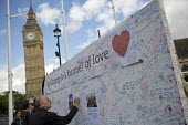 Jo Cox murder. Messages left in Parliament Square wall after the Labour MP was murdered, Westminster, London - Jess Hurd - 2010s,2016,death,deaths,died,FLOWER,flowering,flowers,grieving,Jo Cox,kill,killed,killing,Labour Party,London,memorial,message,messages,mortality,MOURNER,MOURNERS,mourning,MP,murder,murdered,murders,P