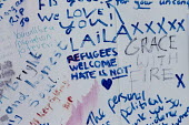 Jo Cox murder. Messages left in Parliament Square wall after the Labour MP was murdered, Westminster, London - Jess Hurd - 2010s,2016,death,deaths,Diaspora,died,displaced,FLOWER,flowering,flowers,foreign,foreigner,foreigners,grieving,hate,hatred,immigrant,IMMIGRANTS,immigration,Jo Cox,kill,killed,killing,Labour Party,Lond