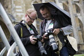 Jo Cox murder. Photographers Eddie Mulholland and Peter Macdiarmid sending photographs in the rain of MPs attending a service remembering murdered Labour MP Jo Cox, St Margarets Church London - Jess Hurd - 20-06-2016