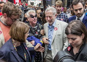Jeremy Corbyn enjoying a joke after a Labour Party rally for Vote Remain in the EU, West Handyside Canopy, King's Cross, London - John Sturrock - 2010s,2016,camera,cameras,campaign,campaigning,CAMPAIGNS,democracy,enjoying,ENJOYMENT,EU,Europe,European Union,funny,humor,humorous,HUMOUR,Jeremy Corbyn,joke,JOKES,joking,Labour Party,laugh,laughing,l