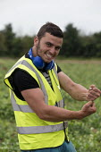 Romanian and Bulgarian migrant workers harvesting broad beans, Warwickshire - John Harris - 2010s,2016,agricultural,agriculture,beans,bulgarian,bulgarians,by hand,capitalism,capitalist,casual workers,crop,crops,Diaspora,EARNINGS,eastern European,eastern Europeans,EBF,Economic,Economy,EMOTION