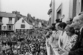 Durham Miners Gala, 1983. Miners and their families march on the 100th Anniversary of the Durham Miners Gala or ^Big Meeting^. Labour Party leaders, including Tony Benn & Neil Kinnock, wave to the pro... - Stefano Cagnoni - 1980s,1983,ACE,activist,activists,anniversary,banner,banners,Big Meeting,CAMPAIGN,campaigner,campaigners,CAMPAIGNING,CAMPAIGNS,centenary,crowd,Culture,DEMONSTRATING,Demonstration,DEMONSTRATIONS,Durham