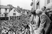 Durham Miners Gala, 1983. Miners and their families march on the 100th Anniversary of the Durham Miners Gala or ^Big Meeting^. Labour Party leaders, Michael Foot, Neil KInnock and Tony Benn watch the... - Stefano Cagnoni - 1980s,1983,ACE,activist,activists,anniversary,banner,banners,Big Meeting,brass,brass band,CAMPAIGN,campaigner,campaigners,CAMPAIGNING,CAMPAIGNS,centenary,Culture,DEMONSTRATING,Demonstration,DEMONSTRAT