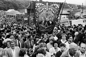Durham Miners Gala, 1983. Miners and their families march on the 100th Anniversary of the Durham Miners Gala or ^Big Meeting^. The Easington Lodge banner leads the way to the fairground held on the Du... - Stefano Cagnoni - 1980s,1983,ACE,activist,activists,anniversary,banner,banners,Big Meeting,brass,brass band,CAMPAIGN,campaigner,campaigners,CAMPAIGNING,CAMPAIGNS,centenary,County Durham,Culture,DEMONSTRATING,Demonstrat
