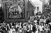Durham Miners Gala, 1983. Miners and their families march on the 100th Anniversary of the Durham Miners Gala or ^Big Meeting^. The Hobson Lodge pit banner is carried back through the streets at the en... - Stefano Cagnoni - 1980s,1983,ACE,activist,activists,anniversary,banner,banners,Beamish Museum,Big Meeting,CAMPAIGN,campaigner,campaigners,CAMPAIGNING,CAMPAIGNS,centenary,County Durham,Culture,DEMONSTRATING,Demonstratio