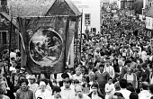 Durham Miners Gala, 1983. Miners and their families march on the 100th Anniversary of the Durham Miners Gala or ^Big Meeting^. The Hedleyhope Lodge banner, bearing the time honoured, Socialist slogan... - Stefano Cagnoni - 1980s,1983,ACE,activist,activists,anniversary,Bankrupt,BANKRUPTCY,banner,banners,Big Meeting,CAMPAIGN,campaigner,campaigners,CAMPAIGNING,CAMPAIGNS,centenary,County Durham,Culture,DEMONSTRATING,Demonst