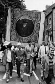 Durham Miners Gala, 1983. Miners and their families march on the 100th Anniversary of the Durham Miners Gala or ^Big Meeting^. The Hylton Lodge pit banner bearing the portrait of Socialist, Keir Hardi... - Stefano Cagnoni - 1980s,1983,ACE,activist,activists,anniversary,banner,banners,Big Meeting,CAMPAIGN,campaigner,campaigners,CAMPAIGNING,CAMPAIGNS,centenary,County Durham,Culture,DEMONSTRATING,Demonstration,DEMONSTRATION