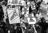 Amnesty International protest march to mark Prisoner of Conscience week, London, 1983. - Stefano Cagnoni - 1980s,1983,activist,activists,Amnesty,Amnesty International,CAMPAIGN,campaigner,campaigners,CAMPAIGNING,CAMPAIGNS,DEMONSTRATING,demonstration,DEMONSTRATIONS,FEMALE,freedom,Human Rights,imprisonment,in