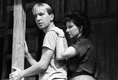Alan Rickman and Leslee Udwin acting in The Grass Widow by Snoo Wilson, Royal Court Theatre, London, 1983 - Stefano Cagnoni - 1980s,1983,ACE,act,acting,actor,actors,actress,actresses,Alan Rickman,cities,city,Court,culture,drama,DRAMATIC,entertainment,FEMALE,Grass,Leslee Udwin,London,people,person,persons,play,PLAYING,Rickman