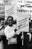 BBC workers strike and picket for better pay for lower graded staff, secretaries, celerical workers, BBC Broadcasting House, London, 1984. - Stefano Cagnoni - 1980s,1984,ABS,BAME,BAMEs,BBC,black,BME,bmes,BROADCAST,Broadcasting,clerical staff,DISPUTE,DISPUTES,diversity,EARNINGS,EQUALITY,ETA,ethnic,ethnicity,female,House,houses,Income,INCOMES,INDUSTRIAL DISPU