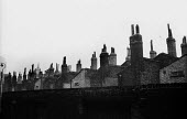 London rooftops near The Cut, 1964 - Romano Cagnoni - 1960s,1964,chimney,chimneys,cities,city,HO,housing,Housing Estate,housing stock,London,PEOPLE,roof,roofs,rooftop,rooftops,Social Issues,SOI,terrace,terraced,Terraced Houses,terraces,The Cut,urban