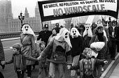Protest against Windscale nuclear power plant, London, 1983. BNFL renamed it Sellafield - Stefano Cagnoni - 1980s,1983,activist,activists,against,atomic,banner,banners,BNFL,campaign,campaigner,campaigners,campaigning,CAMPAIGNS,child,CHILDHOOD,children,DEMONSTRATING,demonstration,DEMONSTRATIONS,environment,e