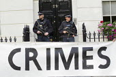 Armed police as protesters try and arrest Tony Blair for war crimes outside his house on the publication of the Chilcot Report on the Iraq war. London. - Jess Hurd - 06-07-2016
