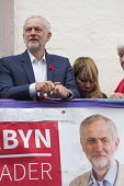 Durham Miners Gala 2016 Jeremy Corbyn watching the procession from the balcony of the County Hotel, Durham, Co' Durham - Mark Pinder - 2010s,2016,Durham Miners Gala,Hotel,HOTELS,Jeremy Corbyn,Labour Party,Left,left wing,Leftwing,member,member members,members,MINER,Miners,MINER'S,MP,MPs,NUM,people,POL,political,politician,politicians,