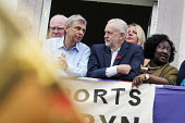 Durham Miners Gala 2016 Dave Prentis Unison and Jeremy Corbyn watching the procession from the balcony of the County Hotel, Durham, Co' Durham - Mark Pinder - 2010s,2016,Durham Miners Gala,Hotel,HOTELS,Jeremy Corbyn,Labour Party,Left,left wing,Leftwing,member,member members,members,MINER,Miners,MINER'S,MP,MPs,NUM,people,POL,political,politician,politicians,