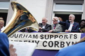 Durham Miners Gala 2016 Jeremy Corbyn watching the procession from the balcony of the County Hotel, Durham, Co' Durham - Mark Pinder - 2010s,2016,bands,Brass Band,Durham Miners Gala,Hotel,HOTELS,Jeremy Corbyn,Labour Party,Left,left wing,Leftwing,member,member members,members,MINER,Miners,MINER'S,MP,MPs,NUM,people,POL,political,politi