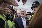 Jeremy Corbyn is mobbed by supporters after his speech, Durham Miners Gala 2016, Co Durham - Mark Pinder - 2010s,2016,County Durham,Durham Miners Gala,EMOTION,EMOTIONAL,EMOTIONS,greeting,hand,hands,handshake,handshaking,Jeremy Corbyn,Labour Party,Left,left wing,Leftwing,member,member members,members,MINER,