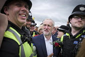 Jeremy Corbyn is mobbed by supporters after his speech, Durham Miners Gala 2016, Co Durham - Mark Pinder - 2010s,2016,adult,adults,CLJ,County Durham,Durham Miners Gala,EMOTION,EMOTIONAL,EMOTIONS,force,Jeremy Corbyn,member,member members,members,MINER,Miners,MINER'S,MP,MPs,NUM,OFFICER,officers,people,POL,PO