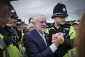 Jeremy Corbyn is mobbed by supporters after his speech, Durham Miners Gala 2016, Co Durham - Mark Pinder - 2010s,2016,adult,adults,CLJ,County Durham,Durham Miners Gala,EMOTION,EMOTIONAL,EMOTIONS,force,greeting,handshake,handshaking,Jeremy Corbyn,Labour Party,Left,left wing,Leftwing,MATURE,member,member mem