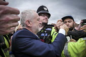 Jeremy Corbyn is mobbed by supporters after his speech, Durham Miners Gala 2016, Co Durham - Mark Pinder - 2010s,2016,adult,adults,CLJ,County Durham,Durham Miners Gala,force,greeting,Jeremy Corbyn,Labour Party,Left,left wing,Leftwing,MATURE,member,member members,members,MINER,Miners,MINER'S,MP,MPs,NUM,OFFI