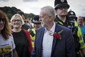 Jeremy Corbyn is mobbed by supporters after his speech, Durham Miners Gala 2016, Co Durham - Mark Pinder - 2010s,2016,County Durham,Durham Miners Gala,EMOTION,EMOTIONAL,EMOTIONS,Jeremy Corbyn,Labour Party,Left,left wing,Leftwing,member,member members,members,MINER,Miners,MINER'S,MP,MPs,NUM,people,person,pe