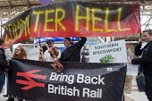Commuters protest against the terrible service by Southern Rail, Victoria Station, London. Regular commuters complain the franchise has cut train services and they have experienced persistent delays a... - Stefano Cagnoni - 2010s,2016,activist,activists,adult,adults,against,banner,banners,British Rail,CAMPAIGN,campaigner,campaigners,CAMPAIGNING,CAMPAIGNS,COMMUTE,Commuter,commuter hell,commuters,COMMUTING,CROWDED,cuts,del