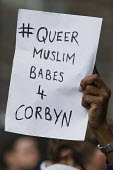 Gay, Muslim supporter outside Labour Party HQ after NEC meeting agreed to include Jeremy Corbyn on ballot for leadership challenge, London - Jess Hurd - 2010s,2016,ballot paper,BAME,BAMEs,Black,BME,bmes,campaign,campaigning,CAMPAIGNS,challenge,DEMOCRACY,diversity,election,elections,equal,ethnic,ethnicity,Gay,Gays,Headquarters,Homosexual,HOMOSEXUALITY,