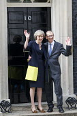Theresa May and her husband Philip John May entering 10 Downing Street as the new Prime Minister, Westminster, London - Jess Hurd - 10 Downing Street,2010s,2016,CONSERVATIVE,Conservative Party,conservatives,doorstep,female,Front Door,husband,London,male,man,men,Minister,MP,MPs,people,person,persons,POL,political,politician,politic