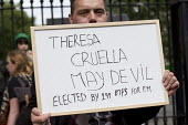 Protest about democracy as Theresa May enters 10 Downing Street as the new Prime Minister, Westminster, London. - Jess Hurd - 10 Downing Street,2010s,2016,activist,activists,against,anti,CAMPAIGN,campaigner,campaigners,CAMPAIGNING,CAMPAIGNS,Cruella De Vil,Cruella Devil,democracy,DEMONSTRATING,demonstration,DEMONSTRATIONS,fem