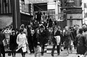 Early morning commuters from Kent leaving Cannon Street Station, London, summer, 1965 - Patrick Eagar - 1960s,1965,adult,adults,arrival,arrivals,arrive,arrived,arrives,arriving,Bowler Hat,bowler hats,British Rail,businessman,businessmen,cities,City,City of London,City workers,COMMUTE,commuter,commuters,