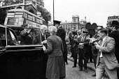 Vietnam Day lobby of Parliament, London, 1965. News cameramen film philosopher Bertrand Russell arriving to join the lobby against British involvement in the war in Vietnam - Romano Cagnoni - 30-06-1965