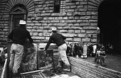 Rescuing artworks from the Florence Floods, Italy, 1966. The floods in Florence in early November 1966 were the worst in over five hundred years and resulted in the loss of over 100 Florentine lives a... - Romano Cagnoni - 1960s,1966,art,ARTEFACT,artefacts,artwork,artworks,BAD,BOOK,books,cities,City,clearing,clearing away,damage,Damaged,damp,dampness,DIA,disaster,disasters,EXTREME,flood,flood damage,flooded,flooding,flo