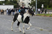 Young traveller boy skilfully riding a piebald pony bareback. Country Fair Day, The Ballinasloe Horse Fair, County Galway, Ireland - David Mansell - , Gipsy, Gypsy, gypsys, Irish Traveller, Roma, Romani, Romany, Rommany,2010s,2012,ACE,animal,animals,Ballinasloe,Ballinasloe October Fair,BAME,BAMEs,bareback,BEMM,BEMMs,BME,bmes,boy,boys,child,CHILDHO