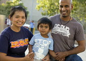 SAN JOSE San Jose, USA. Filipino and an indigenous Indian with their son - David Bacon - 2010s,2013,adult,adults,America,American,americans,Amerindian,Amerindians,BAME,BAMEs,BEMM,BEMMs,Black,BME,bmes,boy,BOYS,child,children,children child,DAD,DADDIES,DADDY,DADS,diversity,ethnic,ethnicity,