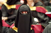 Muslim woman at Graduation ceremony, The Barbican, London - Duncan Phillips - 2010s,2013,achievement,asian asians,BAME,BAMEs,Belief,BEMM,BEMMs,Black,BME,bmes,burka,burkas,burqa,burqas,ceremonies,ceremony,cities,city,clothes clothing,degree,degrees,diversity,dress,edu education,